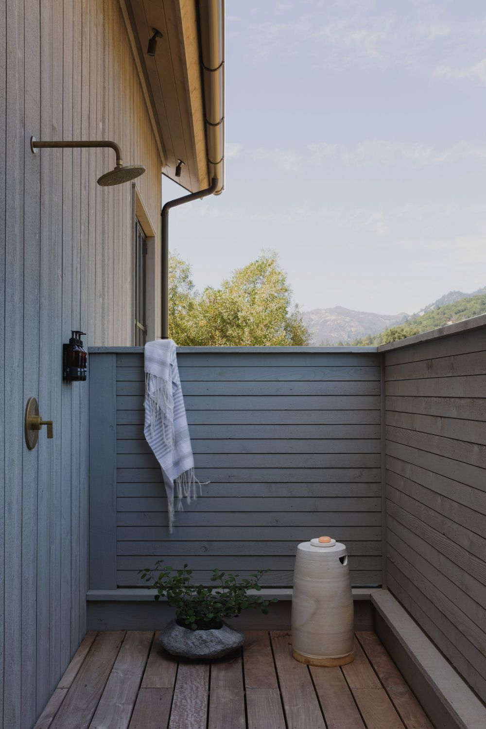 An outdoor shower complements the poolhouse, making the most of this wonderful location