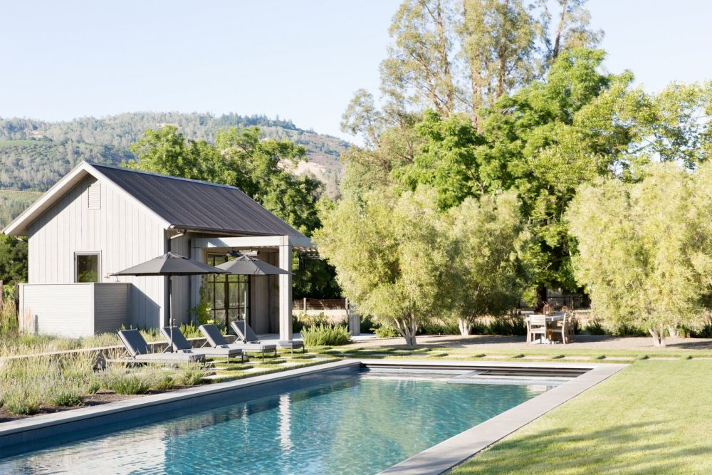 The poolhouse is a smaller version of the main residence, featuring an almost identical design