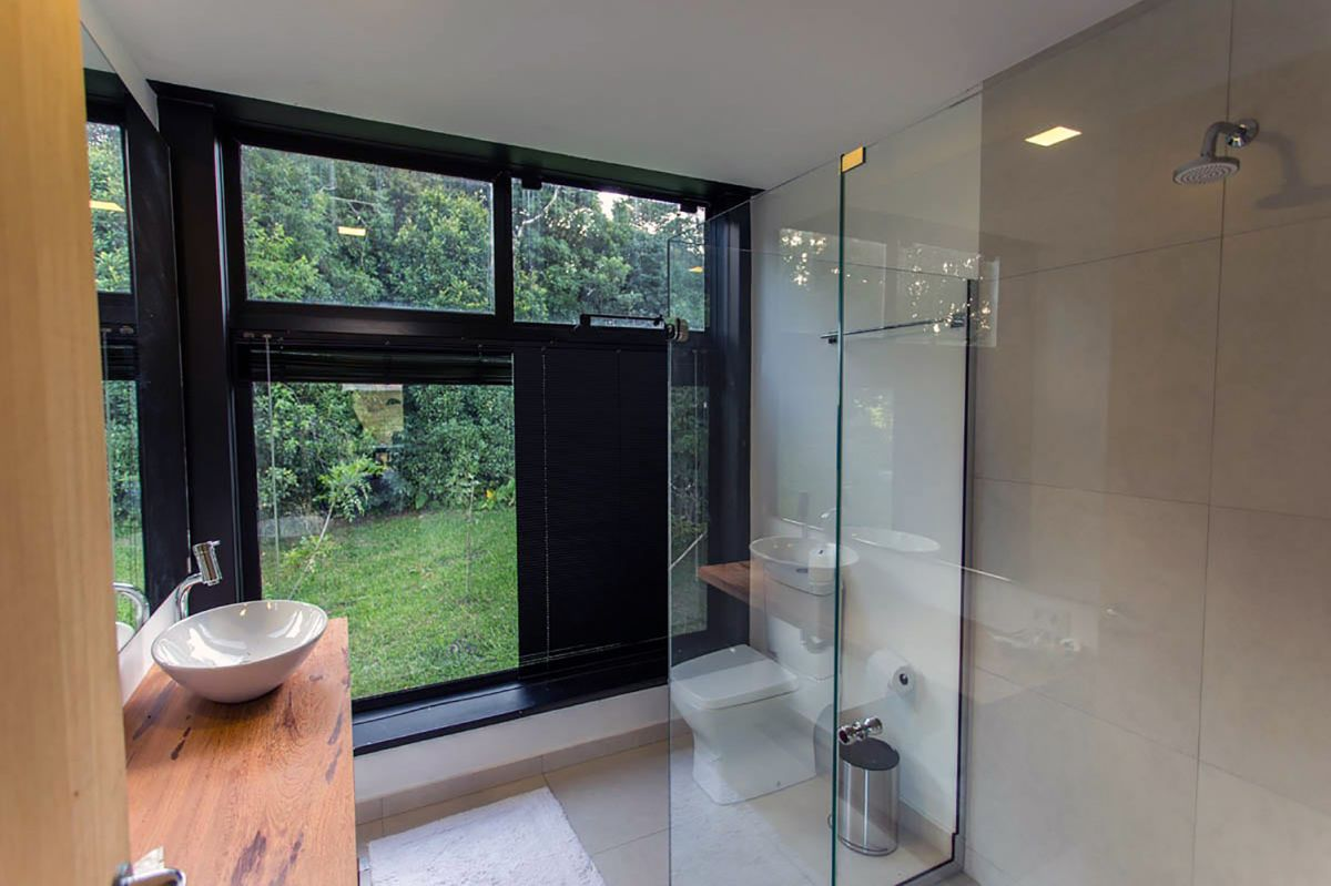 The bathroom has its own share of windows that bring in the beauty of the outdoors