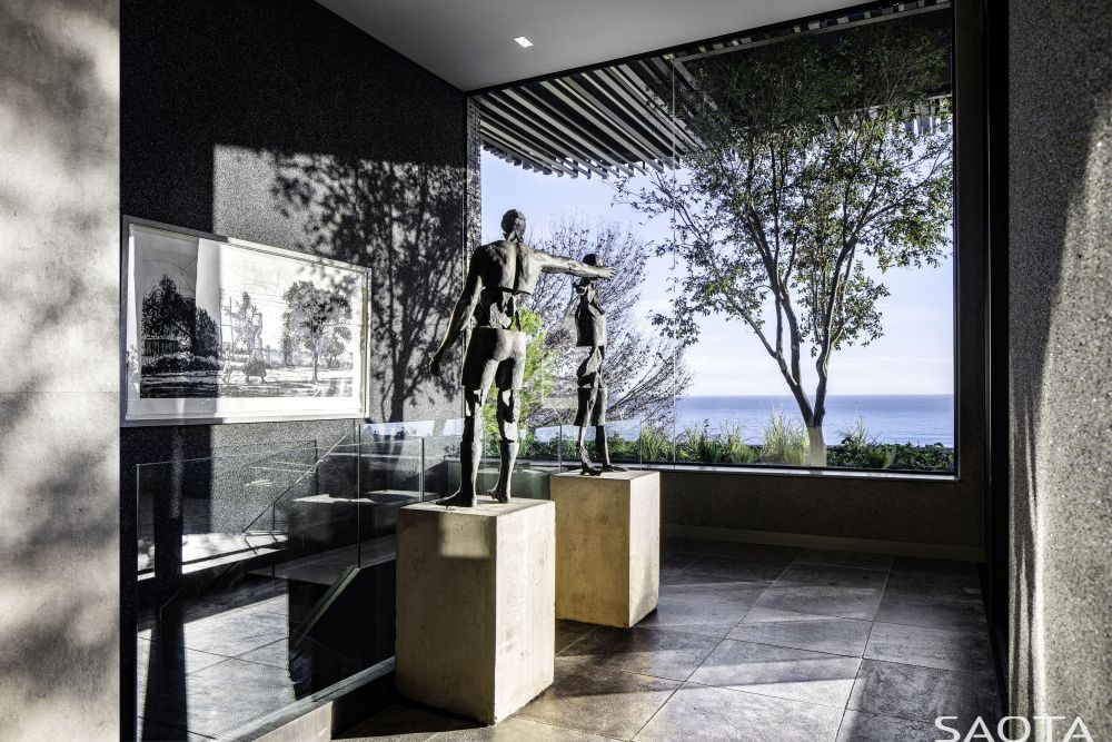 Large windows and openings seamlessly connect the indoor and outdoor and frame these extraordinary views