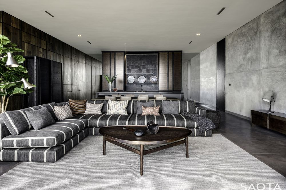 This living room has a large L-shaped sectional which delineates a very inviting sitting area
