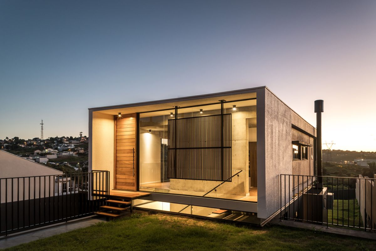 Small Modern House Takes Advantage Of Uneven Topography And A