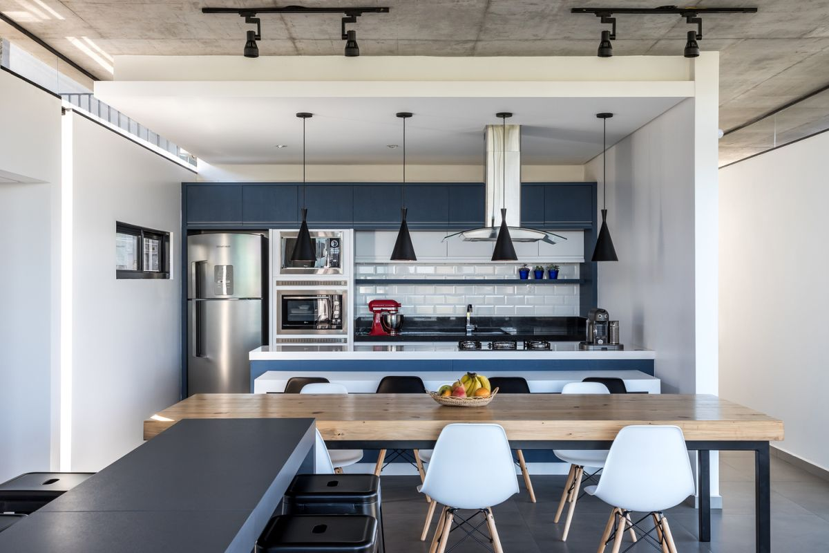 The kitchen is framed by white walls which make it look like its own separate nook