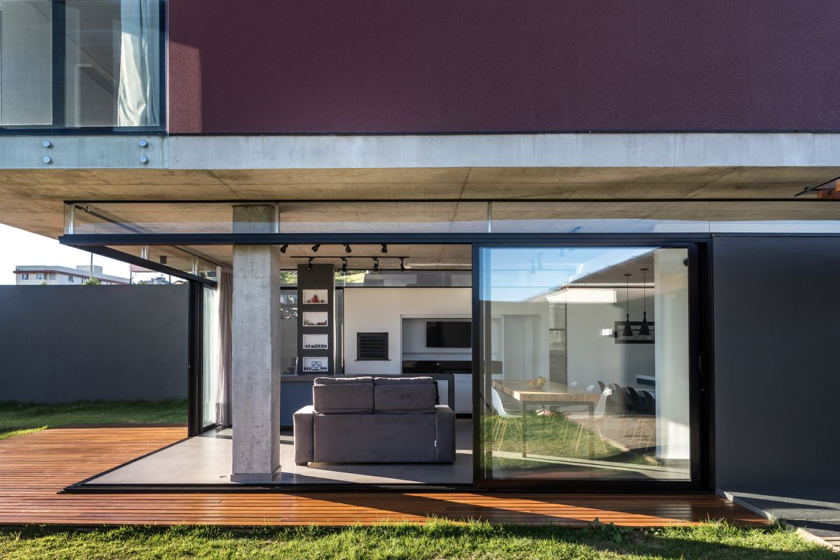 As the sliding glass doors open up, the living room becomes immersed into the landscape