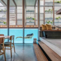 Swimming pool with transparet glass wall