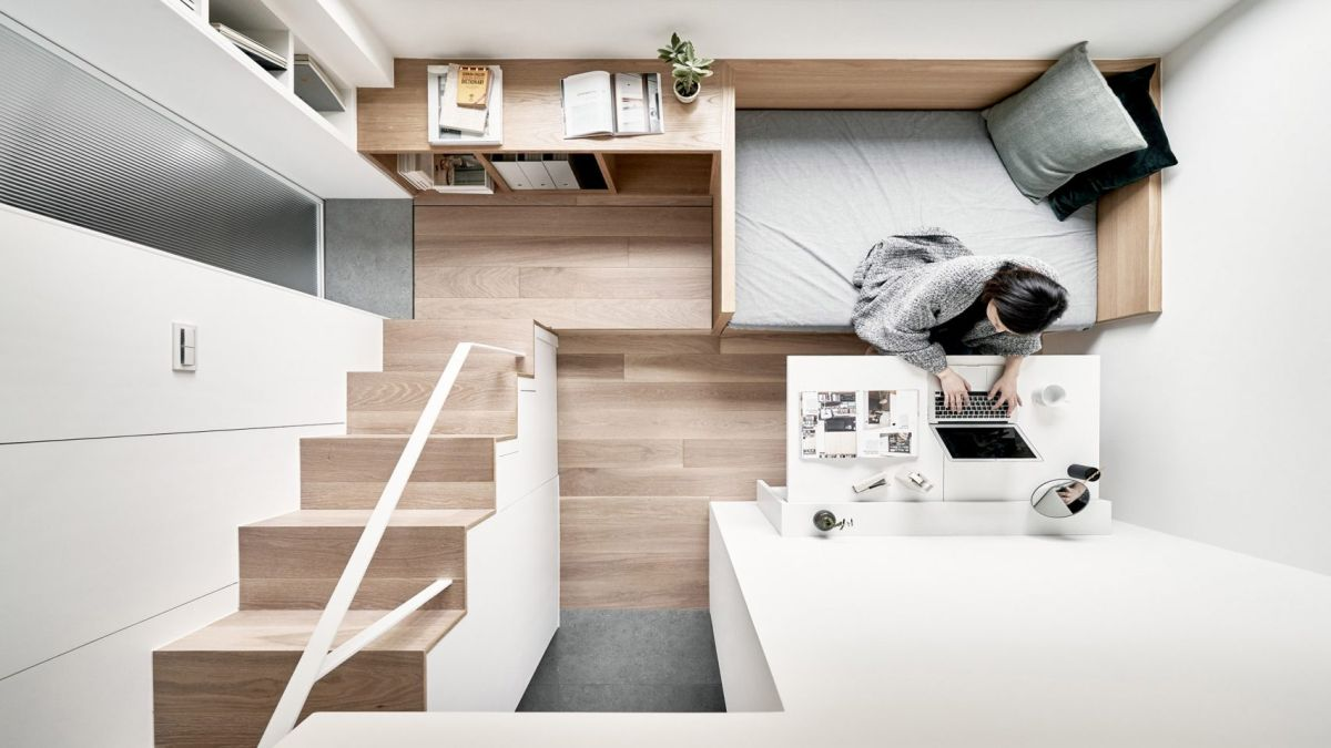 The apartment is tiny and to combat that the architect relied a lot of multifunctional furniture