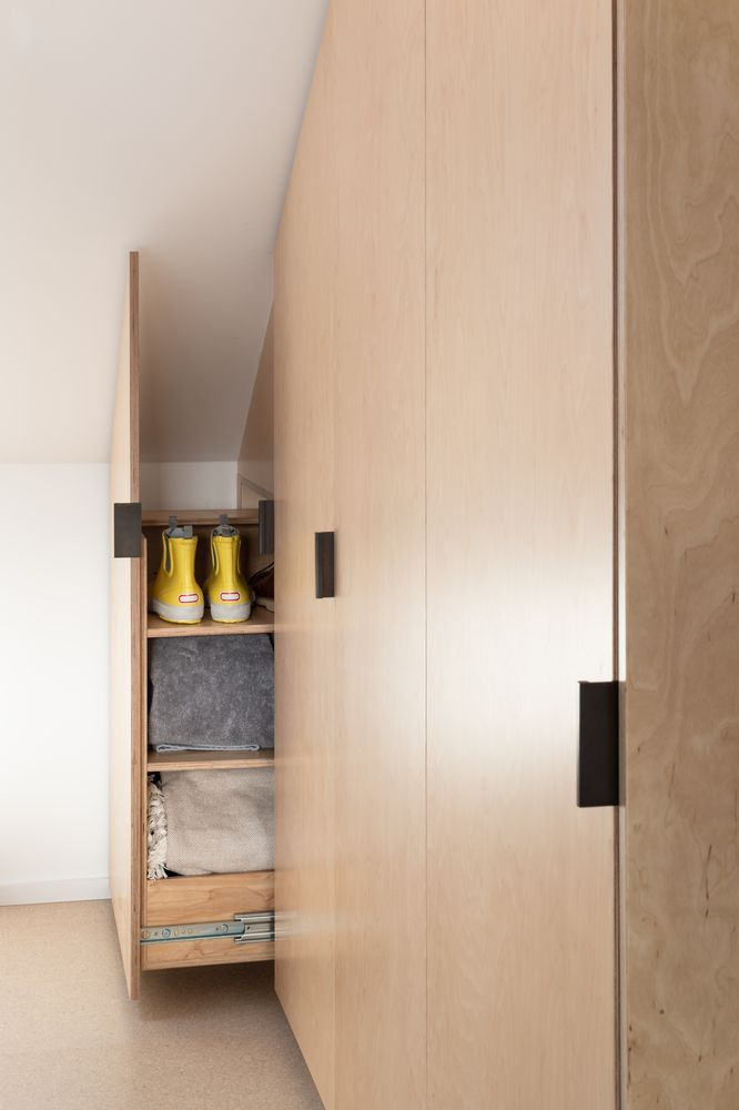 A variety of clever storage solutions were employed throughout the home, including these hidden shelves