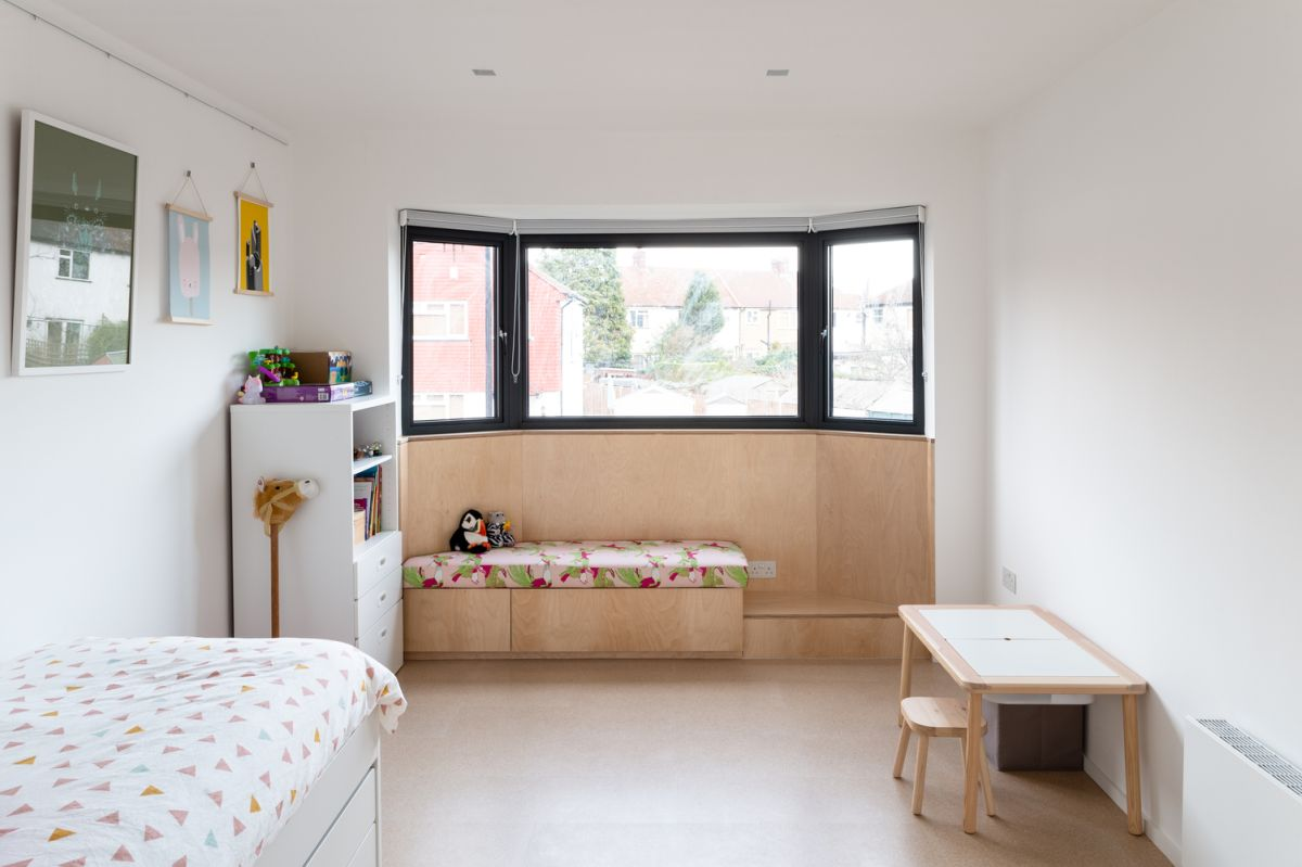 The kids' bedroom has two sections that mirror each other, a perfect design for the twins