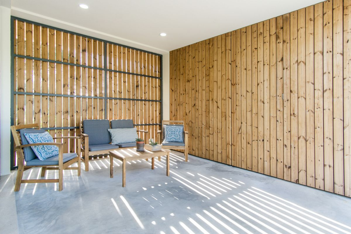 The contrast between crisp white ceiling, polished floor and the warm wood on the walls is a very pleasant one