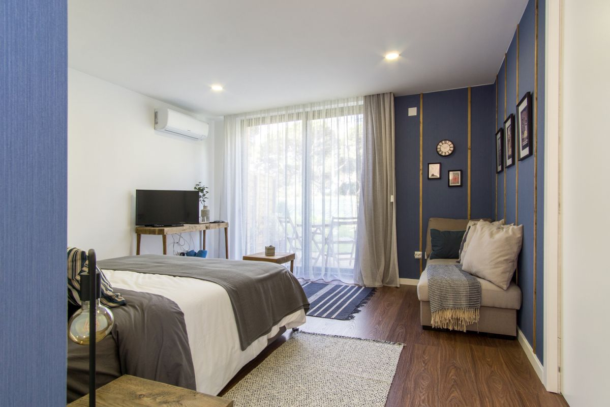 The bedrooms are decorated with cool and relaxing shades of blue complemented by neutrals