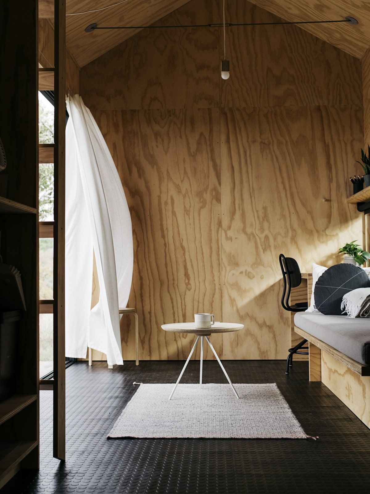 Inside, the cabin features plywood-covered walls, a matching ceiling and rubber floor tiles