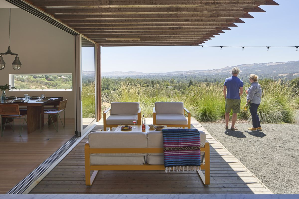 The shaded deck blurs the physical boundaries between the indoor and the outdoor spaces