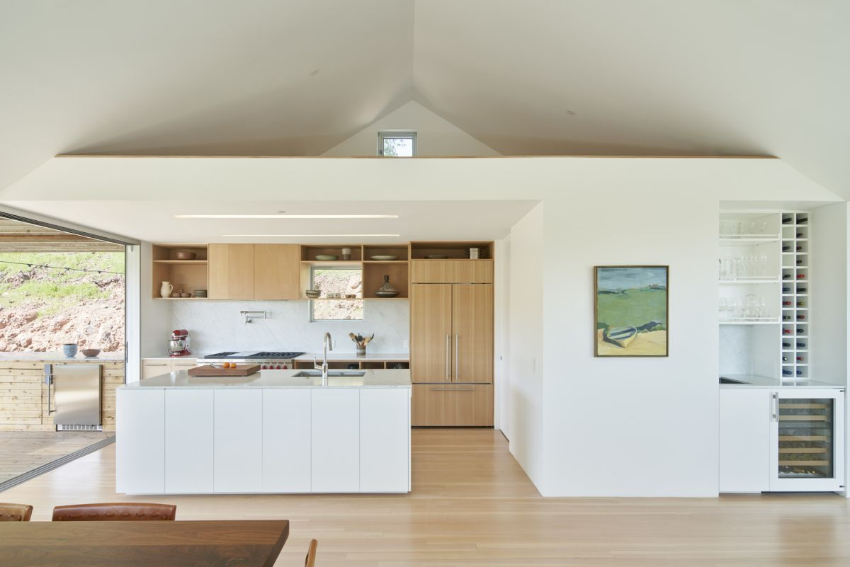 On the inside, the house is simple and bright, with white walls and ceilings and light wooden floors