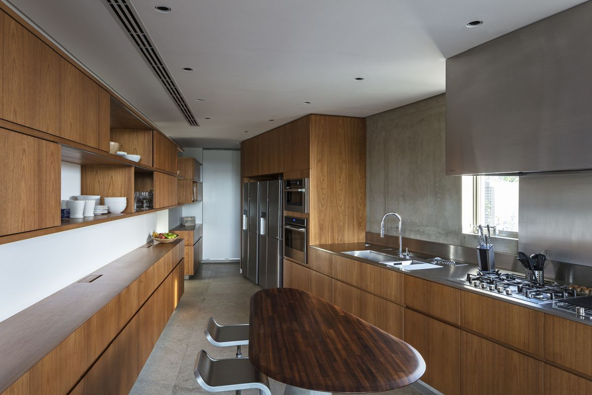 The kitchen is very spacious and has a long and narrow layout seamlessly blended with the dining room