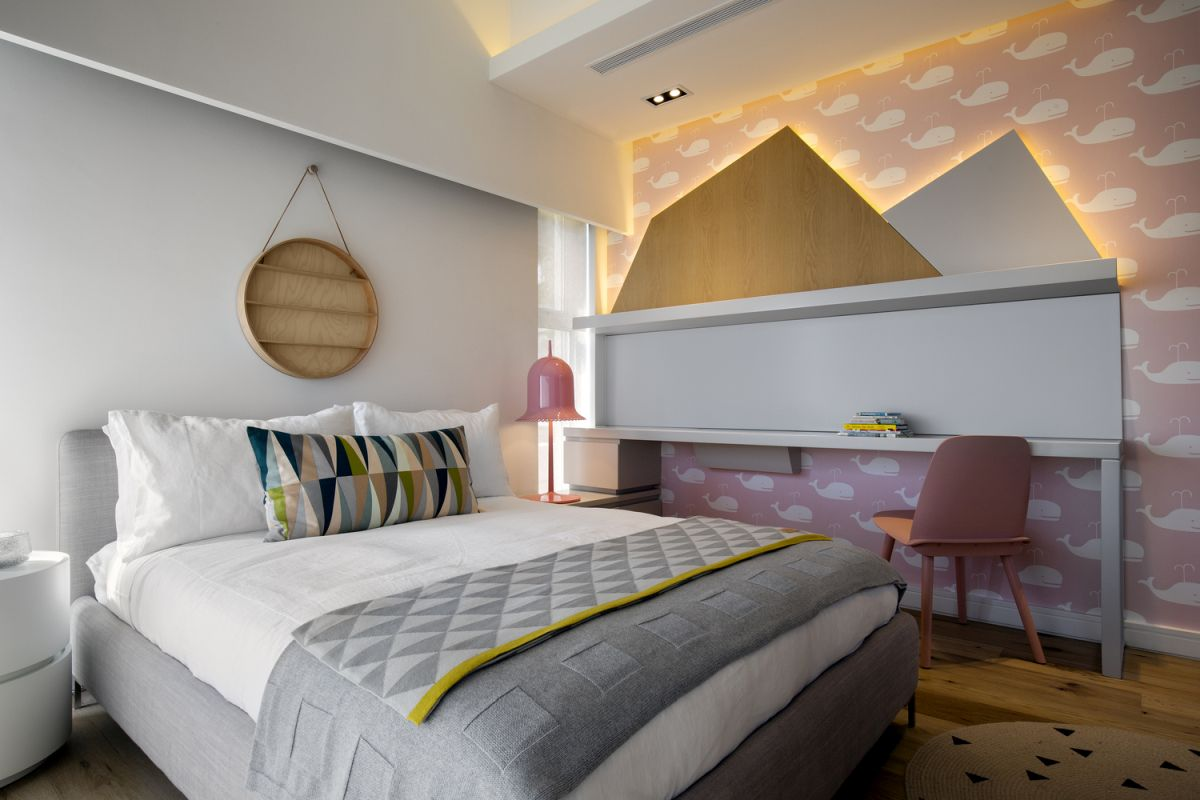 The two bedrooms designed for the children are very chic and playful but retain a simple aesthetic