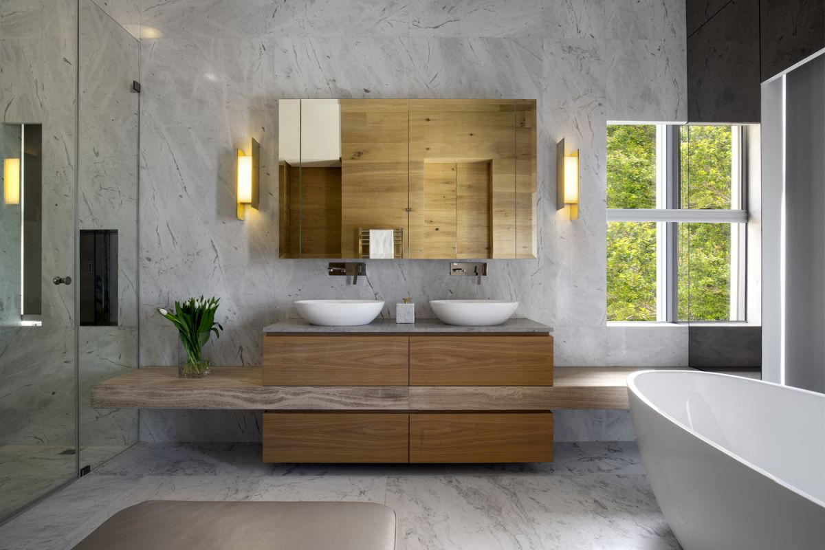 White marble was also used extensively in the bathrooms, where it complements the minimalist fixtures
