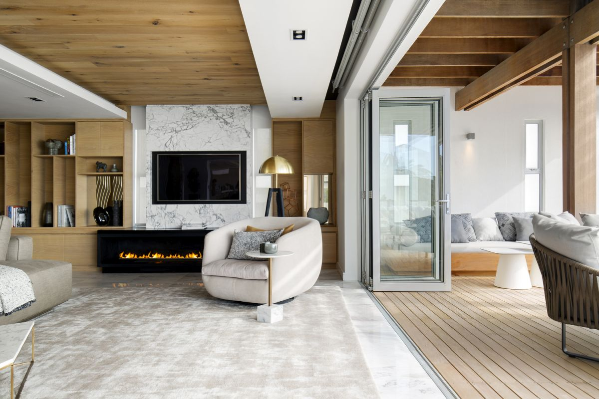 The marble floor and accent wall give the living room a refined and sophisticated look while also looking timeless