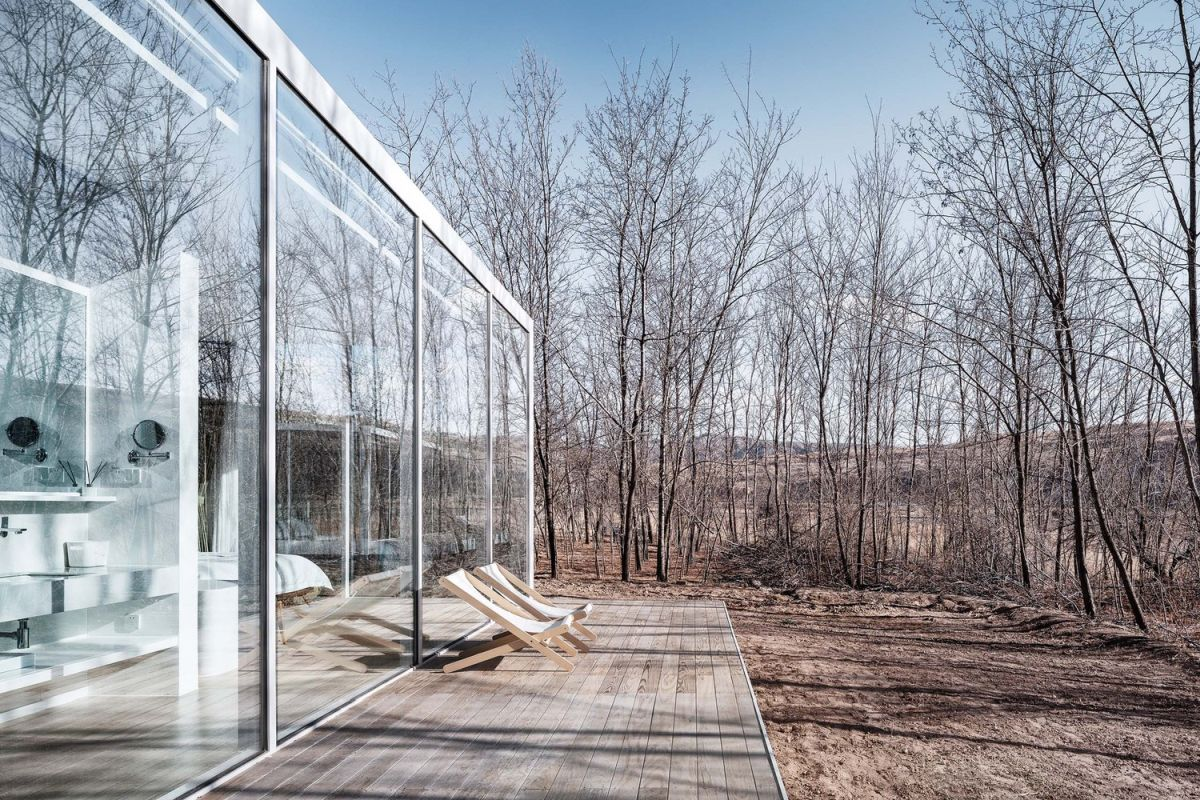 The modules are framed by full-height glass walls on three sides and this opens them up to the views