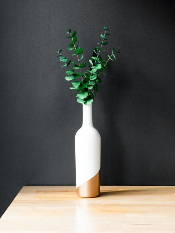 Elegant white and gold wine bottle vase