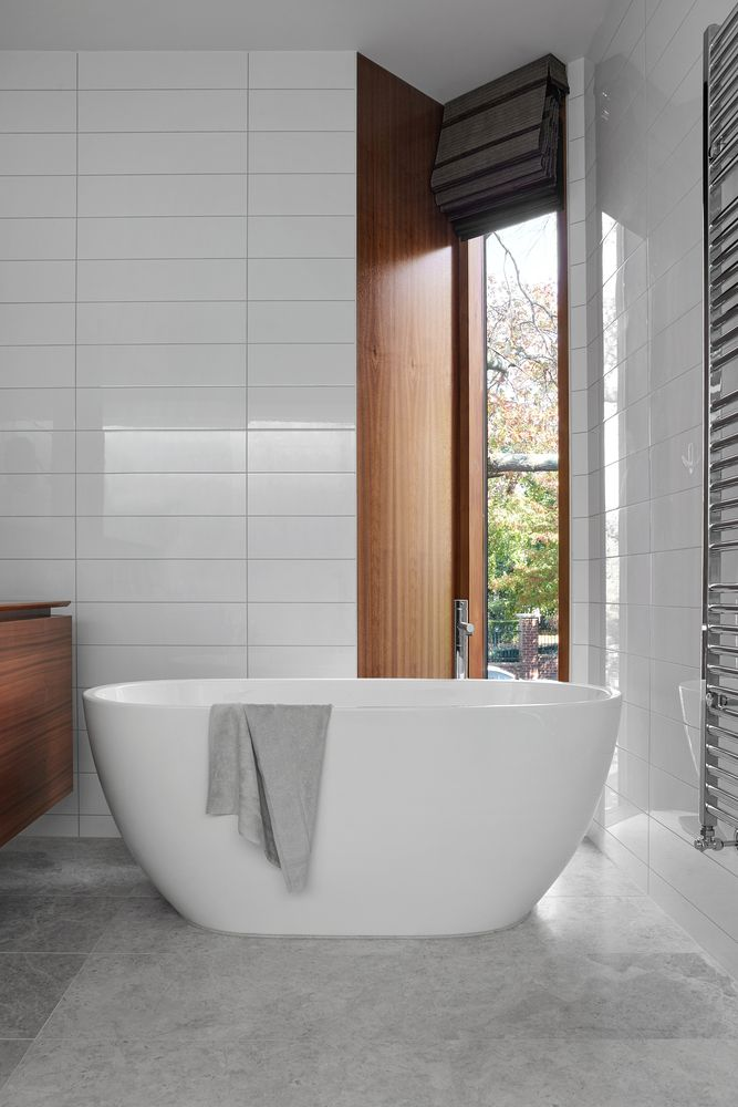 The signature narrow windows complement most spaces, including the elegant bathrooms