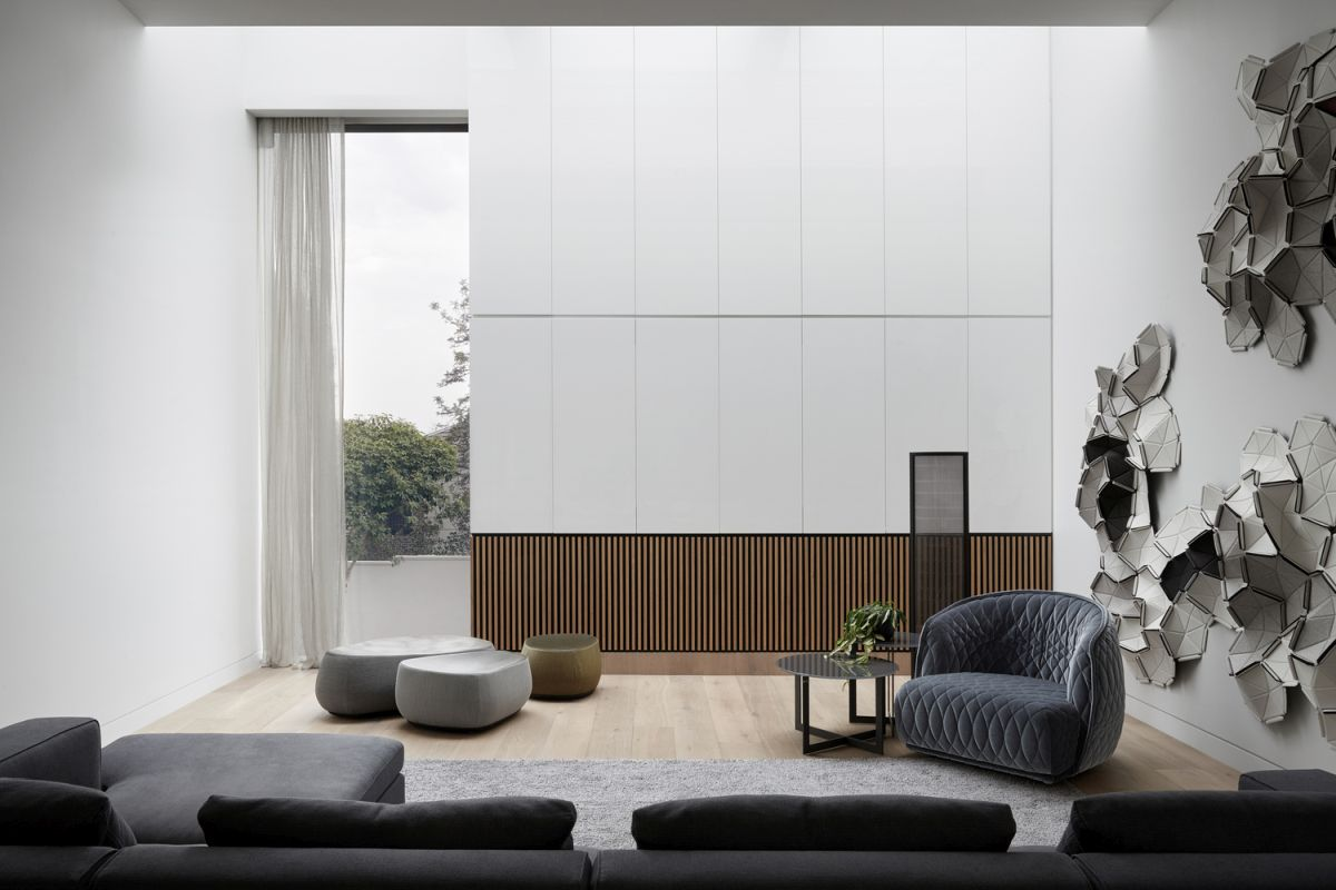 Long and narrow windows let in natural light without exposing the interior to the outside world