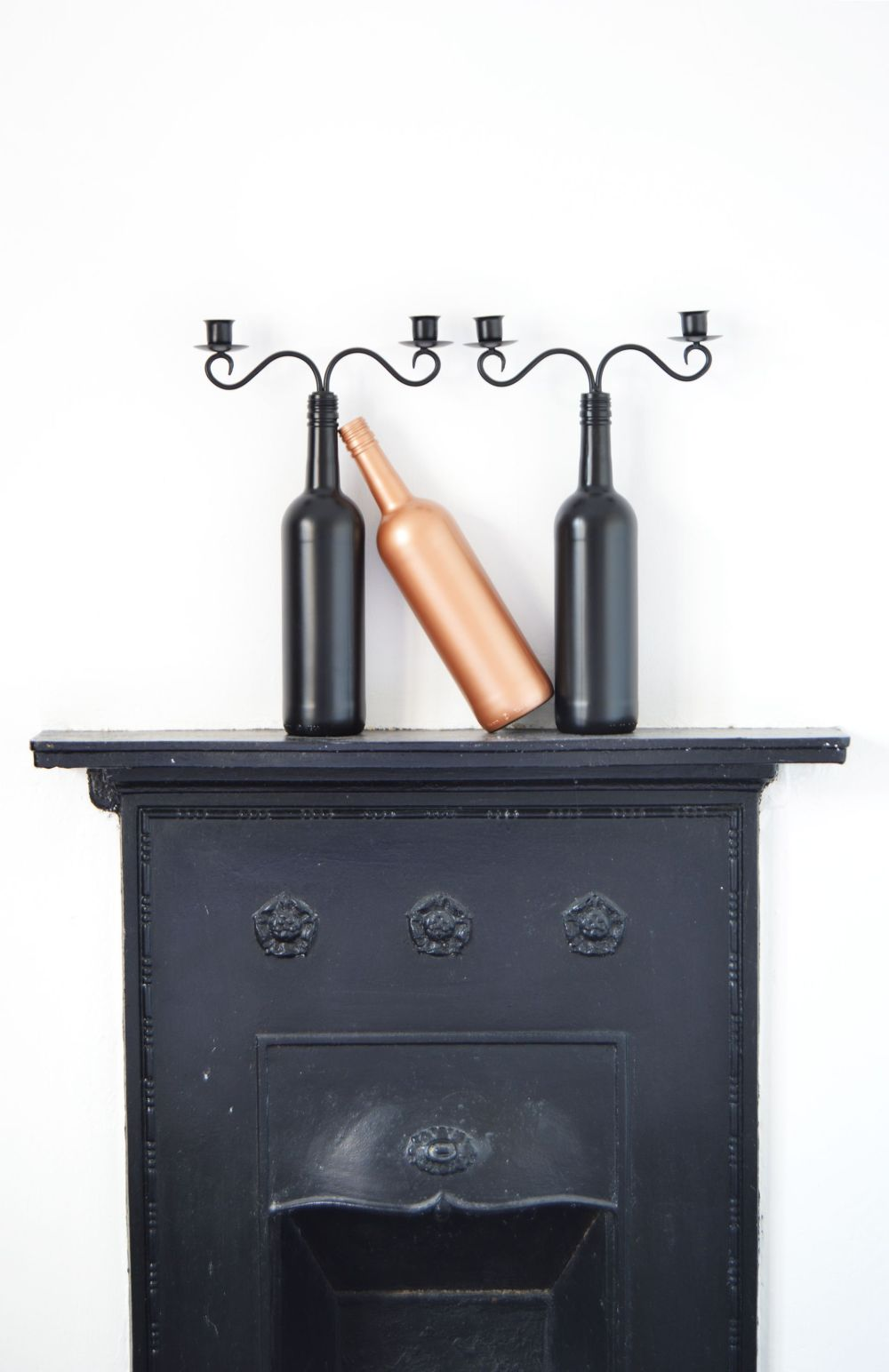 Spray-painted bottle candle holders