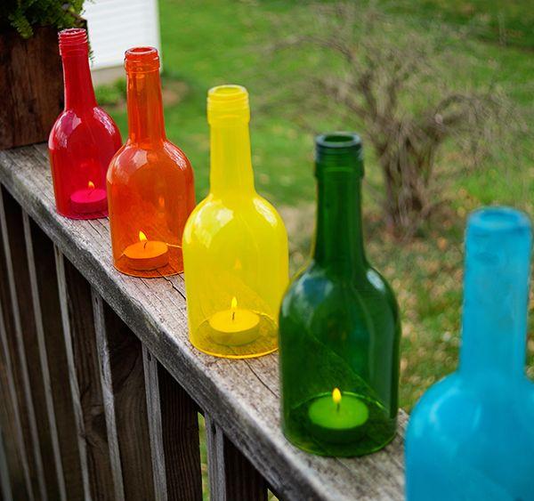 Rainbow lanterns using candles and wine bottles
