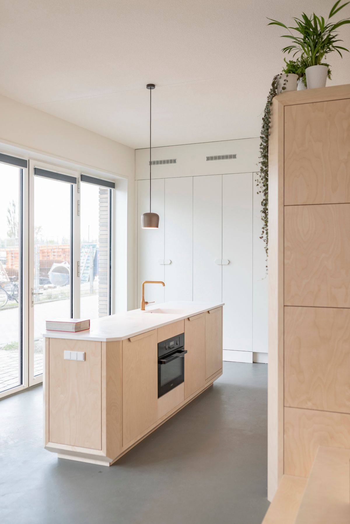 The large windows bring in lots of natural light and expose the common areas to the view