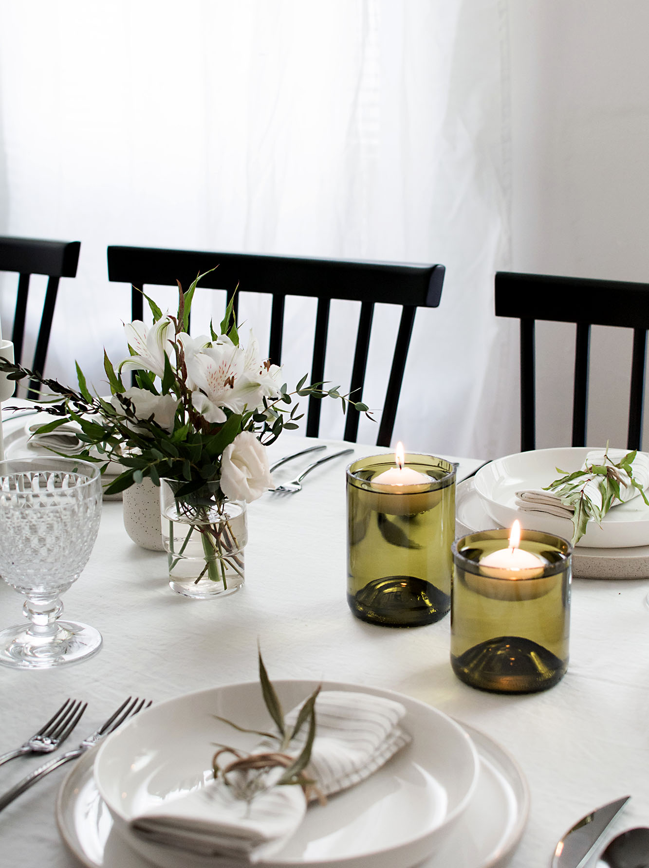 Floating candle holders using cut glass bottles