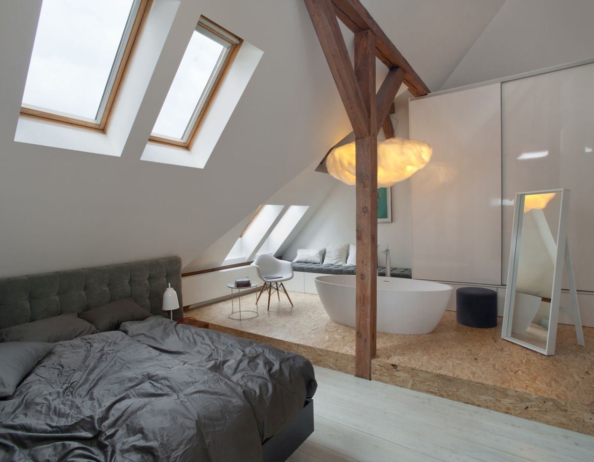 The bedroom has skylight windows and an in-room bathtub which creates a casual look