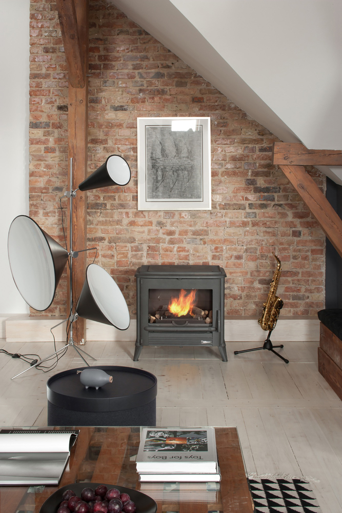 A wood-burning stove in the living room amplify the warm rustic aesthetic of the space