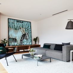 Mid century living room with grey sofa and arc lamp