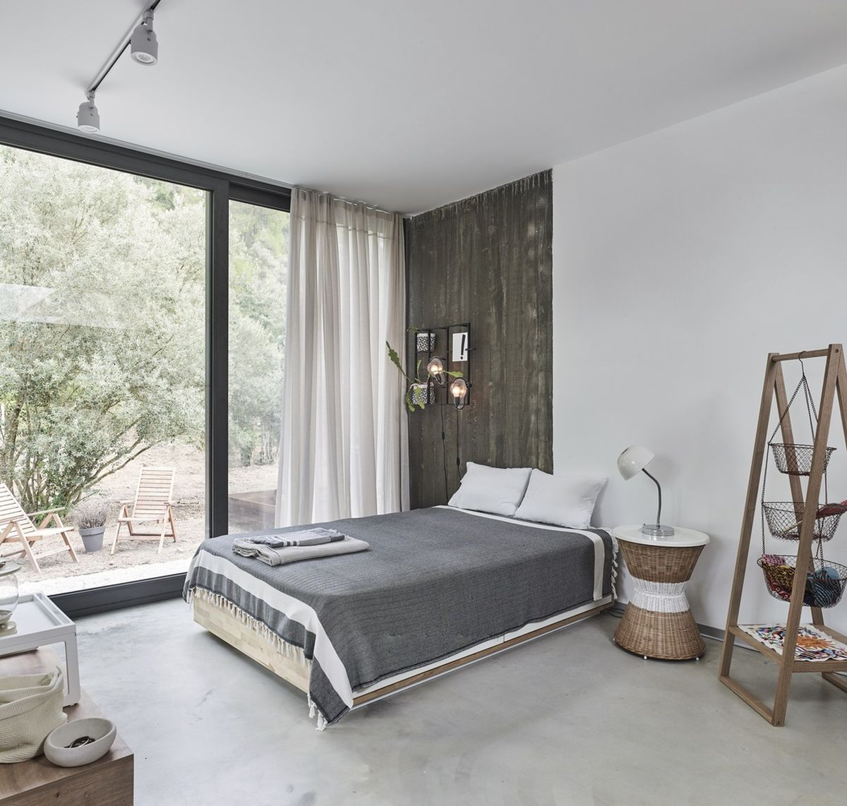 The polished concrete flooring and white walls are complemented by warm wood surfaces