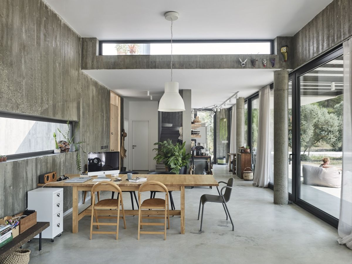 The dining area is a multipurpose space, with the table doubling as a desk
