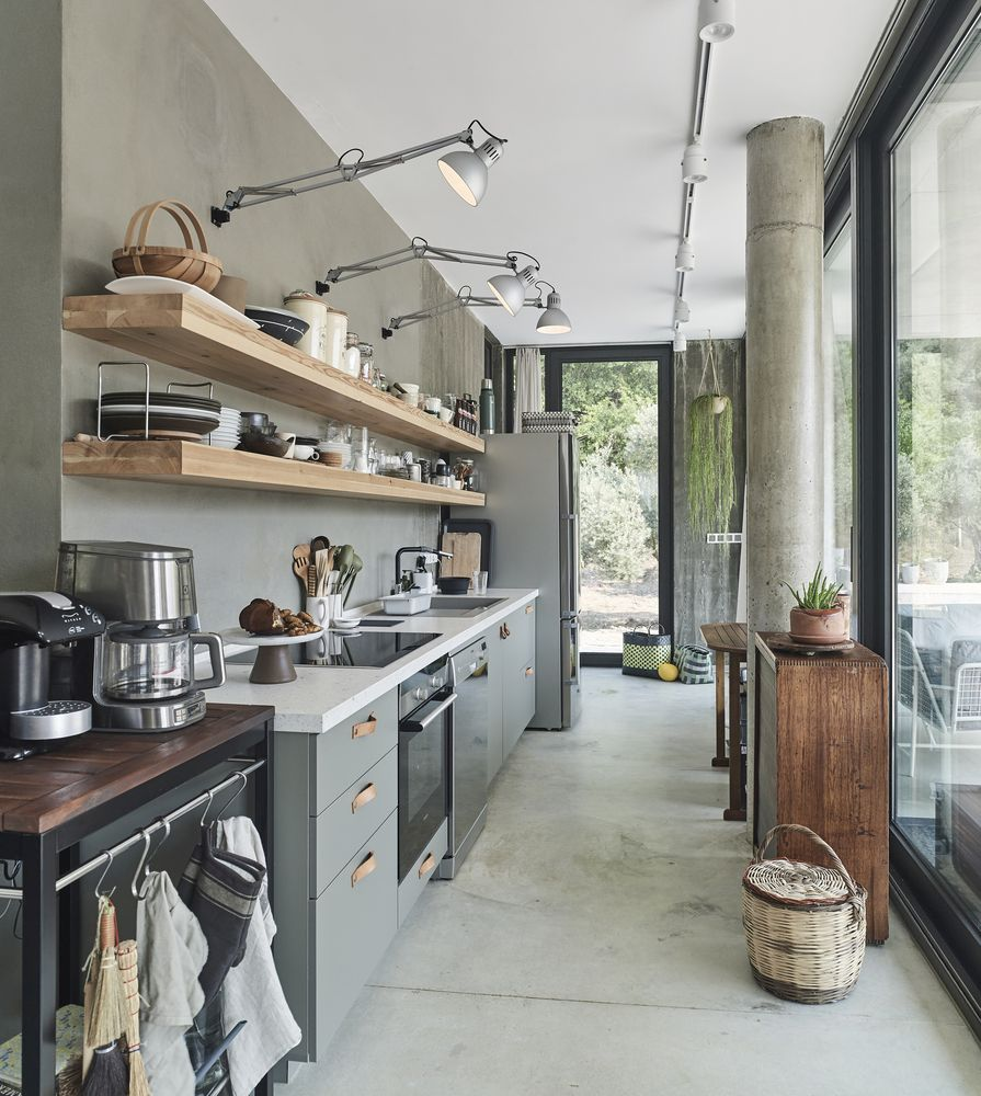 The kitchen is long and narrow but spacious enough and with plenty of storage for everything