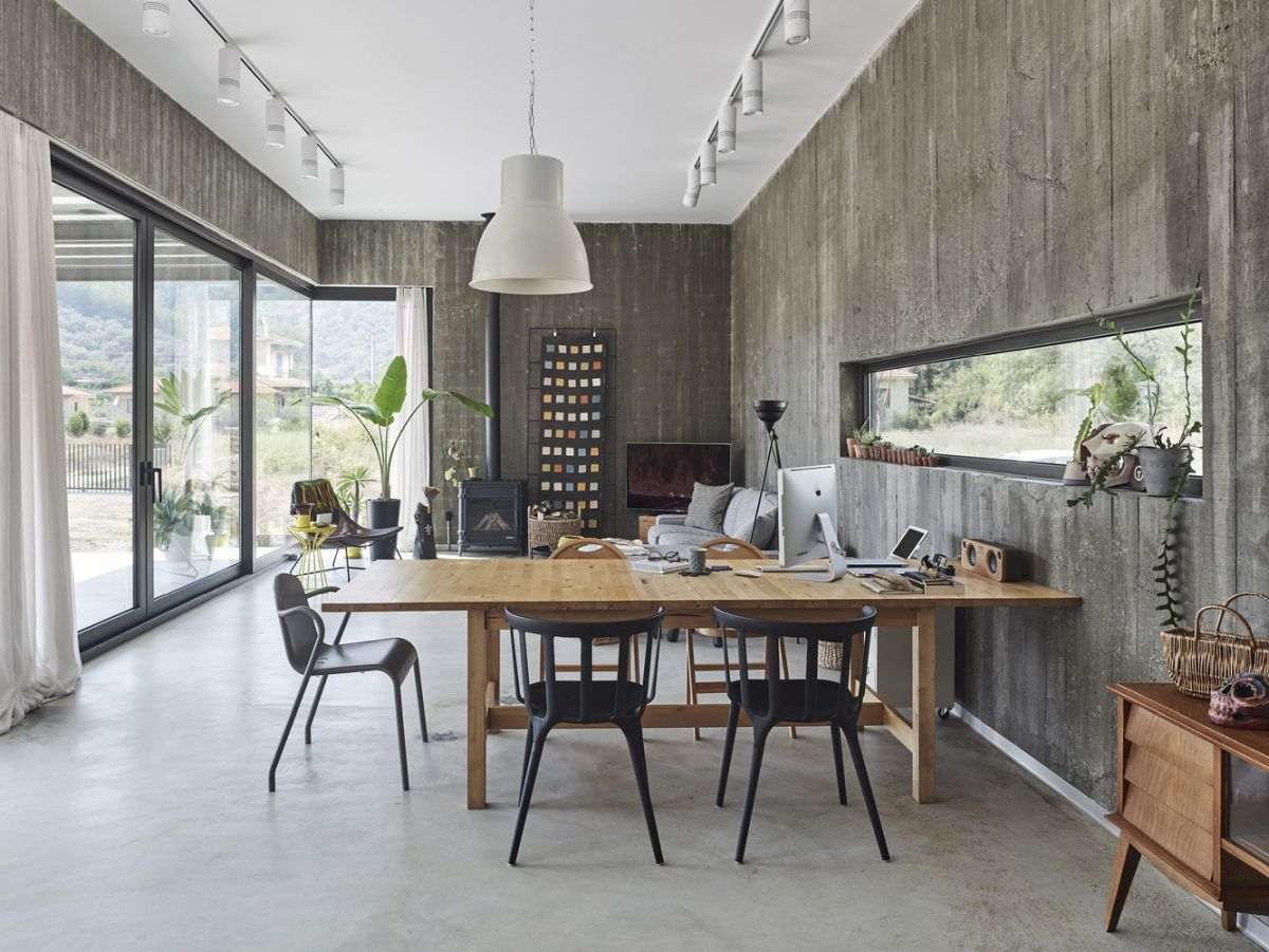 The interior is simple and welcoming, with a design that emphasizes the materials and their natural beauty