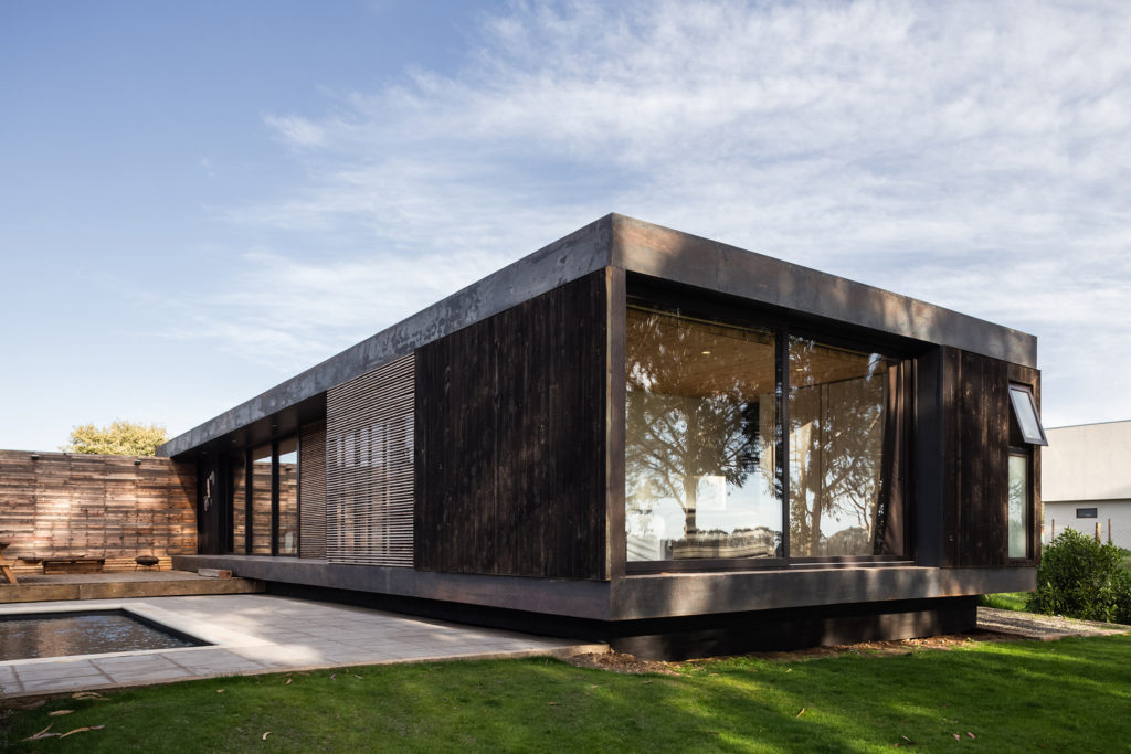 It's easily noticeable that the entire house is slightly raised, a design decision influences by the local climate