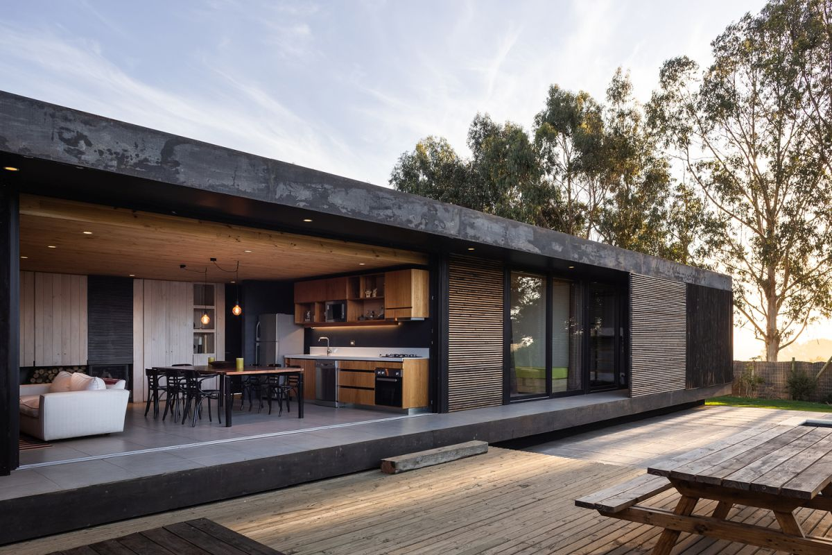 The living area opens toward the courtyard but the transition is not seamless because of the different in flooring height