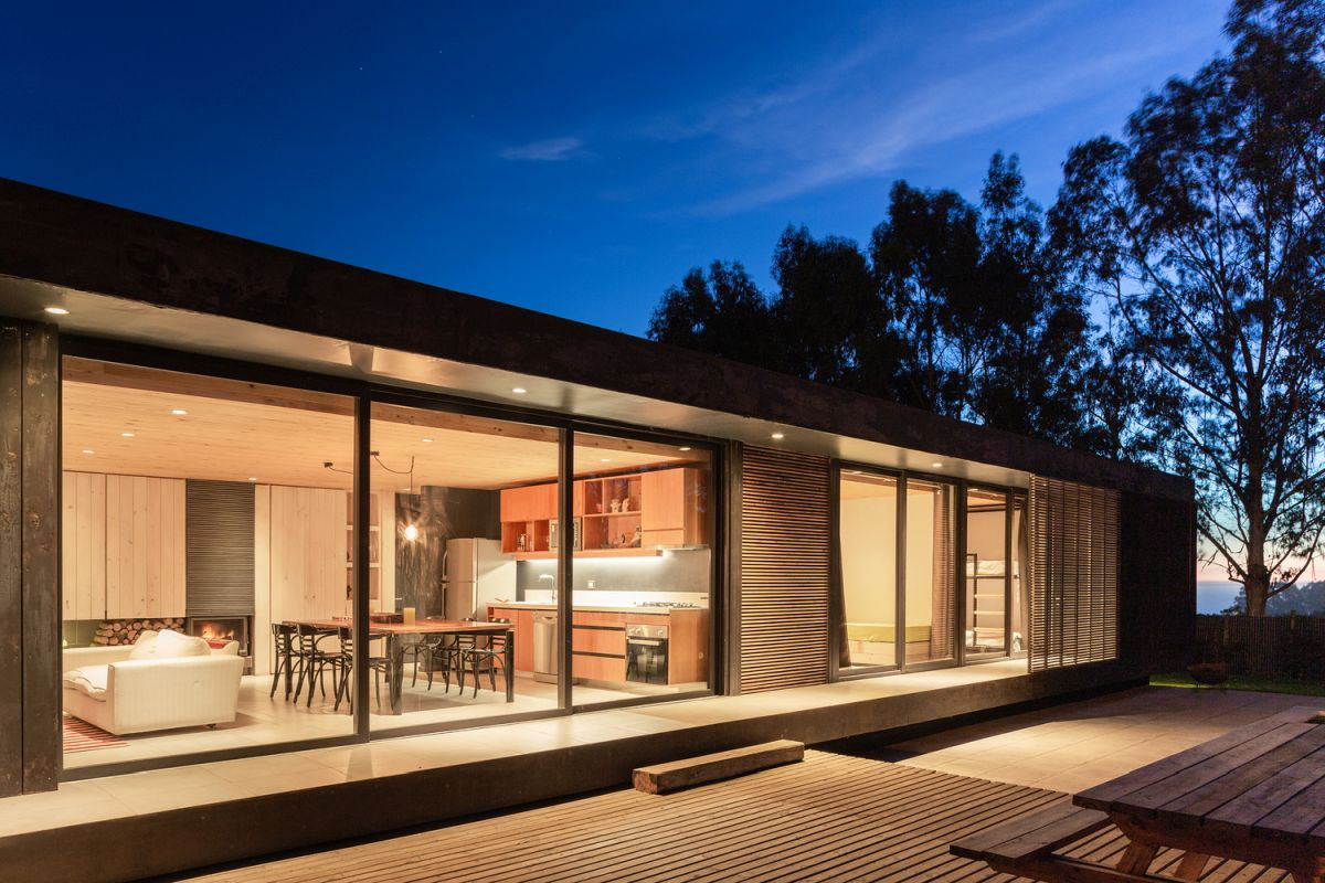 The outdoor deck is positioned at a slightly lower level compared to the internal spaces