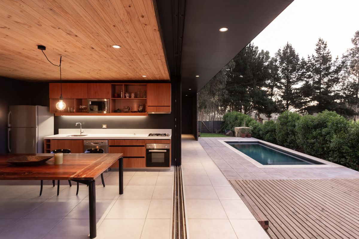 The courtyard has a swimming pool and a wooden deck with a small sitting area