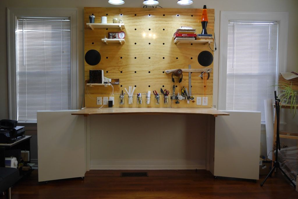 Fold-down work surface with a pegboard wall