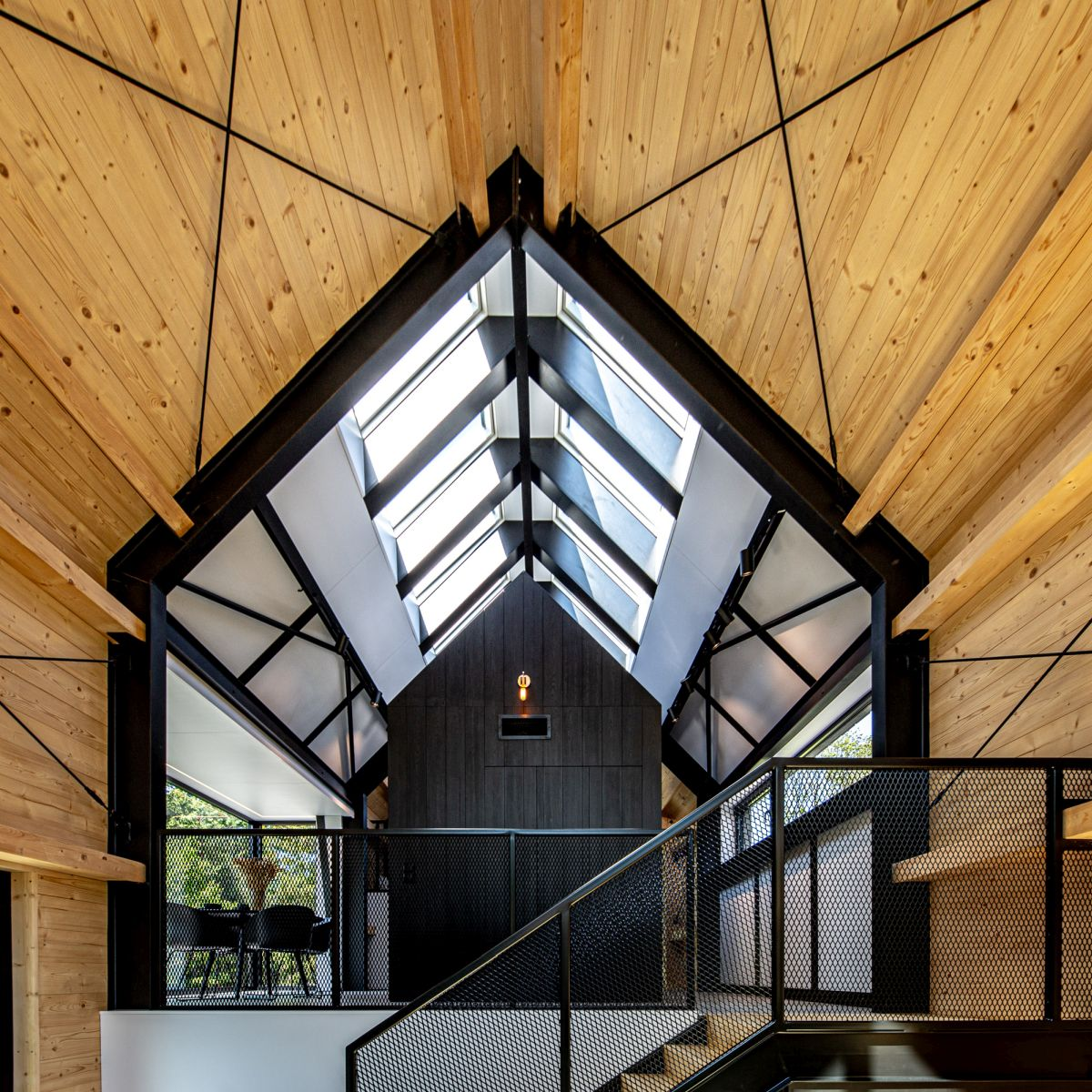 A series of skylights bring natural light into the upstairs volumes