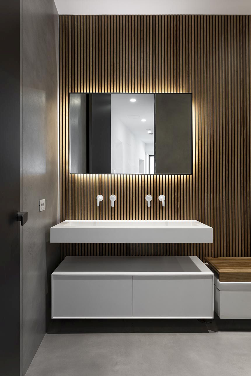 In the bathroom, the backlit mirror has a beautiful glow around it creating a pleasant mood