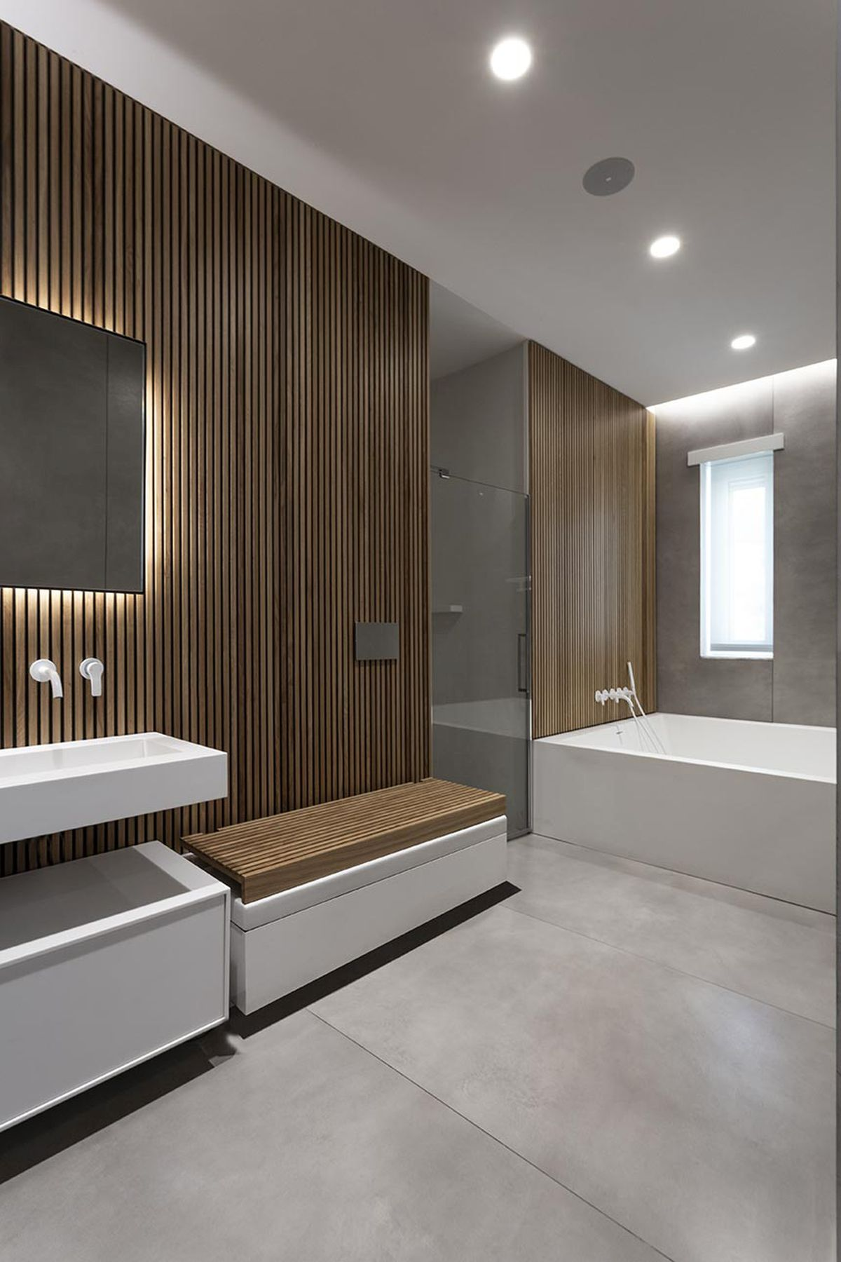 The wood accents and spacious layout give the bathroom a very welcoming and sophisticated look