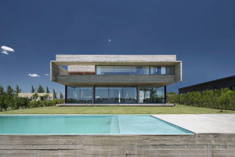 A Modern Concrete House Opens Towards A Beautiful Lagoon