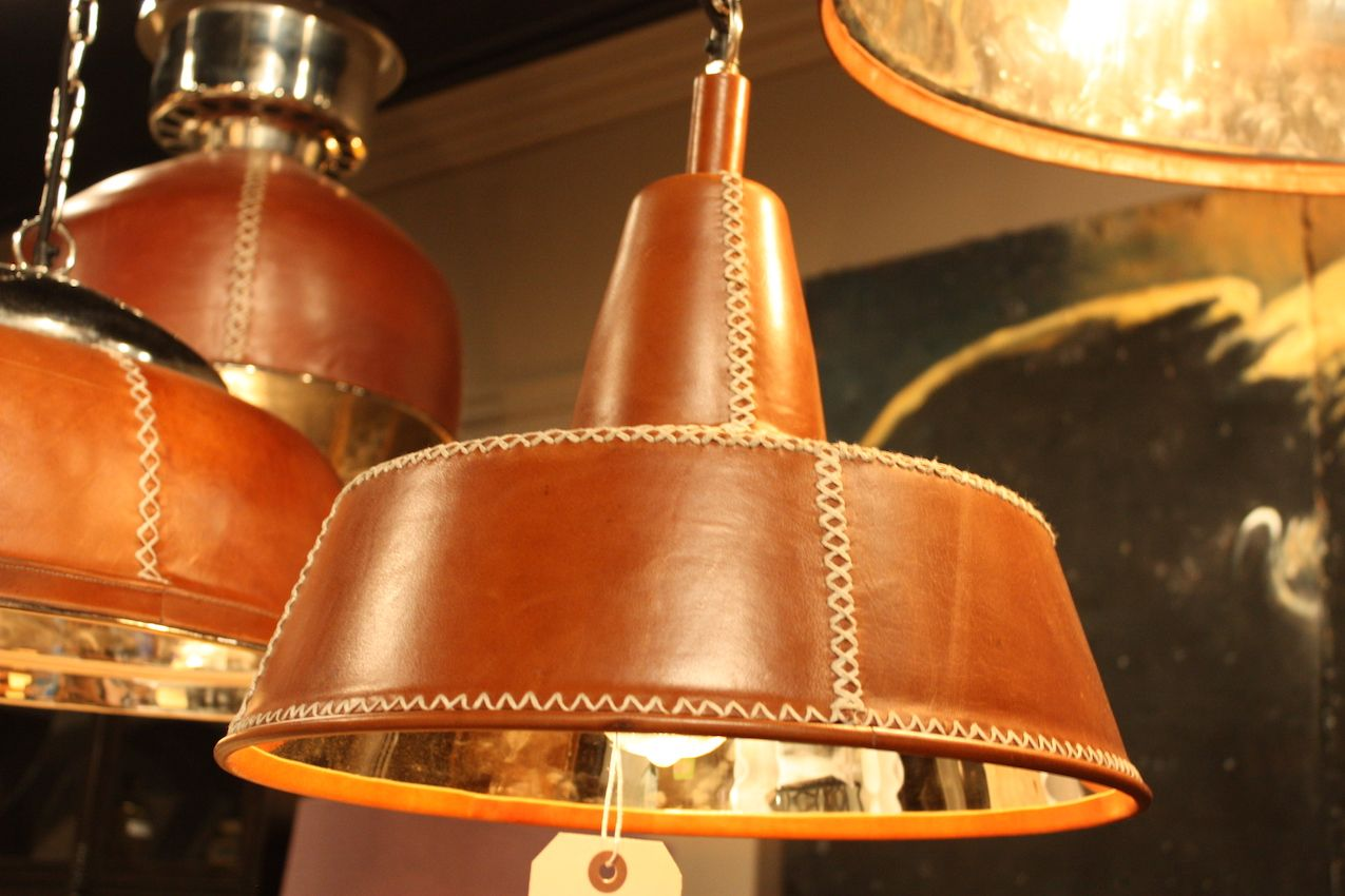 Leather-covered pendants from Bobo Intriguing Objects are warm but rustic.
