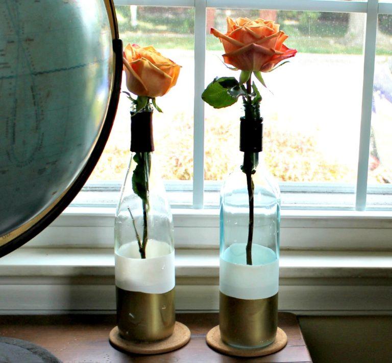 Paint-dipped wine bottle vases