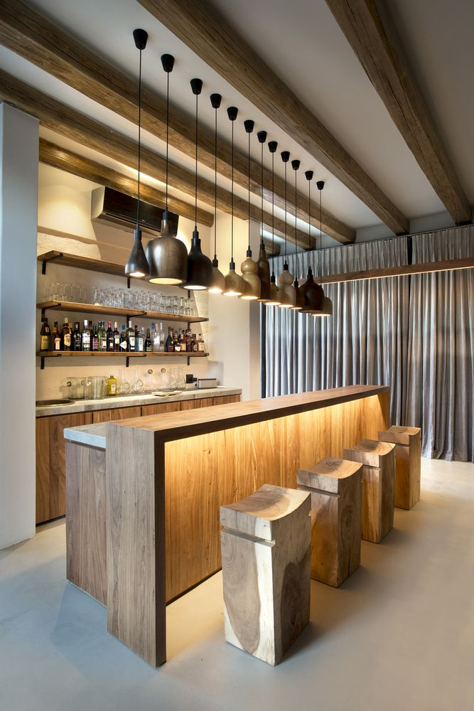 The bar area is quite chic, with a multitude of pendant lamps lined up and stylish chairs