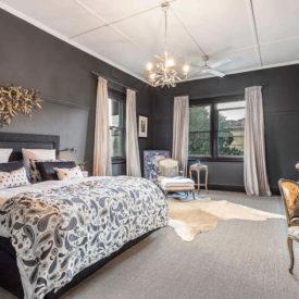 Master bedroom with black walls