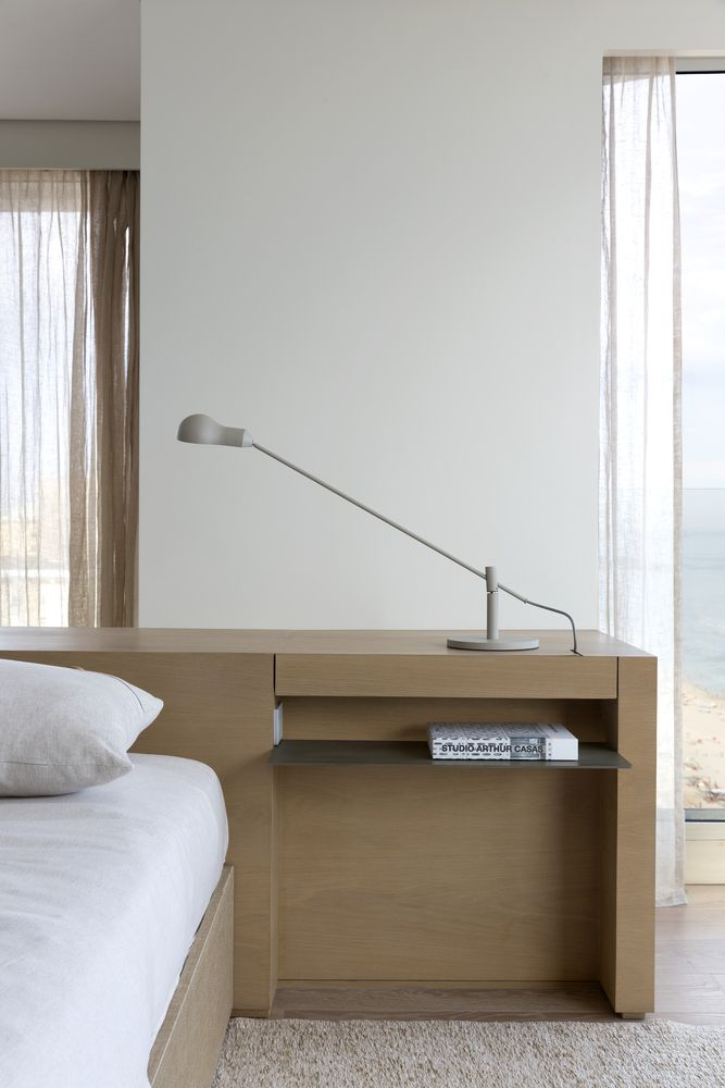 The bedrooms are minimalist and decorated in neutral and warm color tones